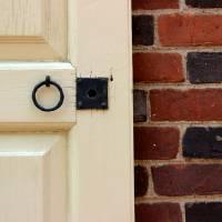 Old Door Knob Brick Wall by Karen Adams