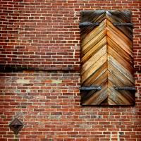 Wooden Shutters Brick Wall by Karen Adams