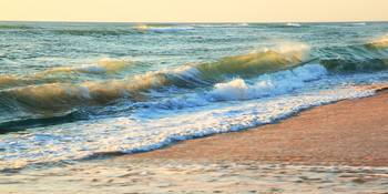 Morning waves roll onto the beach