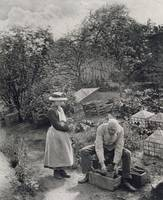 An Old Man and his Daughter Gardening (b&w photo)