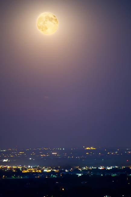 Full Moon Over City Lights