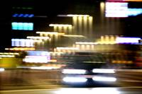 Car in street in urban city lights with surreal di