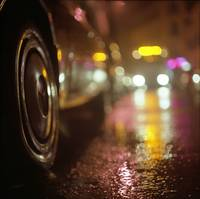 Cars in urban street on rainy night hasselblad med