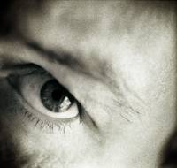 Closeup of eye of man black and white sepia tone