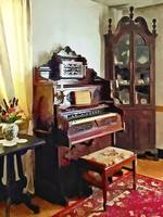 Organ in Victorian Parlor With Vase