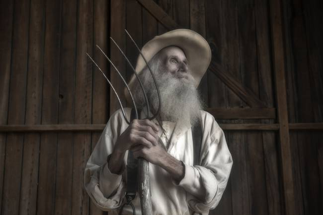 Old Farmer and His Pitchfork