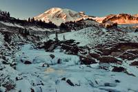 Sunset highlights icy creek below Mount Rainier