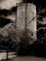 old water tower in sepia