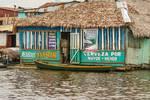 Floating Pub in Shantytown by Allen Sheffield