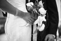 Groom holding bottom of bride black and white wedd