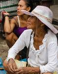 Woman in Hat at Market in Iquitos by Allen Sheffield