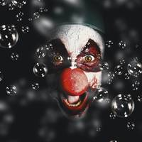Scary horror circus clown laughing with evil smile