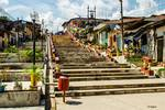 Iquitos - Looking up the Staircase from the Amazon by Allen Sheffield