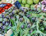 Artichoke - The market in Nice France  by Allen Sheffield