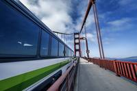 An Express bus speeds on the Golden Gate Bridge