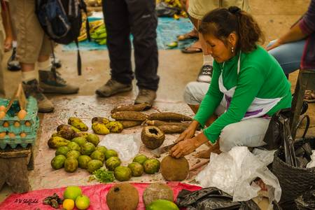 Woman Preparing Fruit in Market