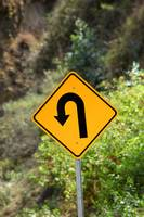 Sharp Left Curve Sign