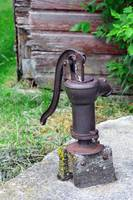Antique Water Pump on a concrete cister