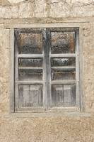 Gray Wooden Shuttered Window