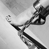 Shackled feet