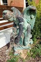 Archangel Statue Capturing Snake