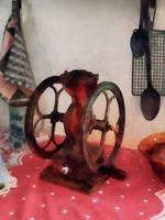 Coffee Grinder on Red Tablecloth