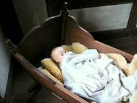 Baby Doll in Cradle