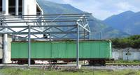 Green Box Car in a Rail Yard
