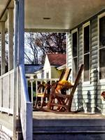 Wooden Rocking Chairs on Porch