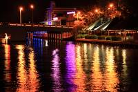 Colorful lights shine on the Intercoastal Waterway