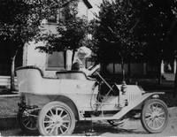 Mrs. William Olds driving new car