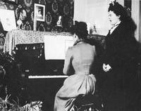 Singers at upright piano