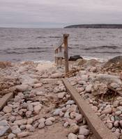 rocky beach with wooden walkway