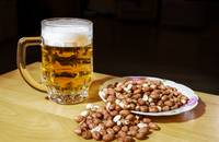 mug of beer and peanuts