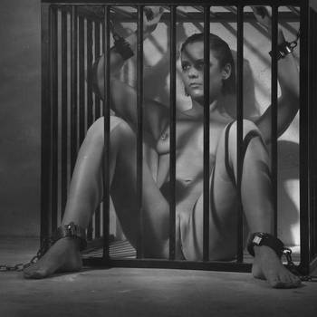 naked girl in a cage