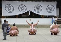 Sumo Wrestler Performing Ritual Prayer at Yasukuni