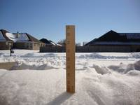 Yard stick measuring snow fall