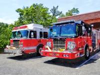 Two Fire Engines in Front of Firehouse