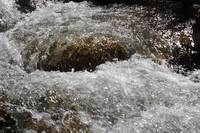The rapids on the mountain river.Water shimmering