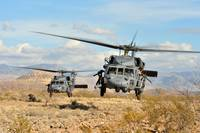 Two HH-60 Pavehawk helicopters land during a perso