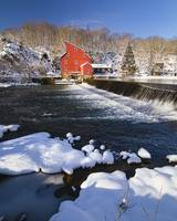 Scenic Winter View of a Waterfall and a Red Mill