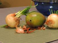 Still Life with Sprouted Onions and Mango