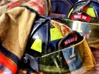 Two Fire Helmets And Fireman's Jacket