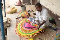 A Man Working on chow dance mask in  Purulia, West
