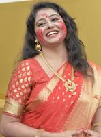 A Sexy Bengali Woman Smiling in Red Saree
