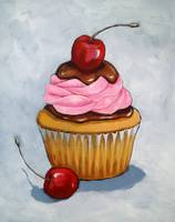 Cupcake With Pink Icing and Cherries
