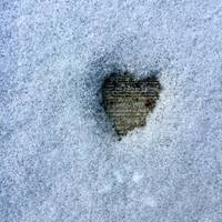 sidewalk heart in winter