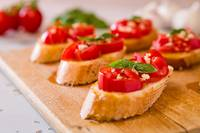 Closeup of Italian bruschetta with tomato, basil a