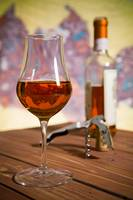 Closeup of a glass of Italian vin santo wine