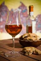 Closeup of glass of Italian vin santo and cantucci